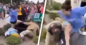 Preacherknocked over by students for carrying sign that says 'women belong in the kitchen